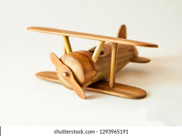 Vintage wooden toy biplane isolated on white background. Made from bamboo.
