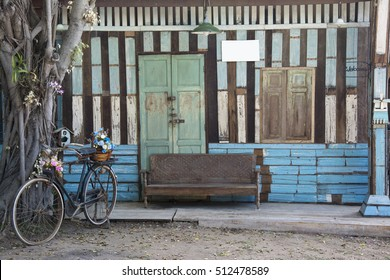 vintage wooden wall with vintage accessories foreground