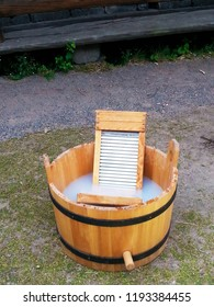 Vintage wooden washtub and washboard