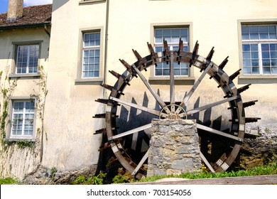Vintage Wooden water wheel or water mill in the Swiss city Neuhausen near The Rhein fall  , purity and the greener , water mill have become a symbol of clean energy.