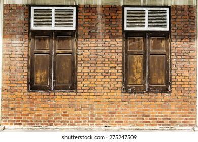 Vintage wooden window on brick wall