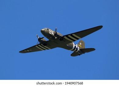 Vintage World War II warbird Douglas C-47 Dakota Skytrain transport plane in flight during D-Day 75 memorial flights over Germany. June 13, 2019
