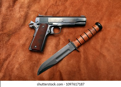 Vintage World War Two .Semi Automatic Pistol and Survival Fighting Knife on leather.
