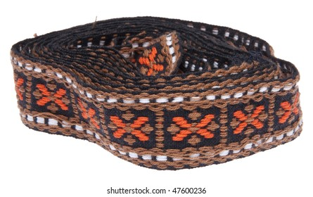 Vintage woven ribbon with orange, brown, black and white colors and an X pattern.  Isolated on white with a clipping path.