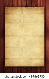 vintage wrinkled paper on wooden background