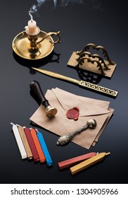 Vintage writing retro set: bronze inkwell, letter opener, old envelopes with wax seal and sealing wax for stamps