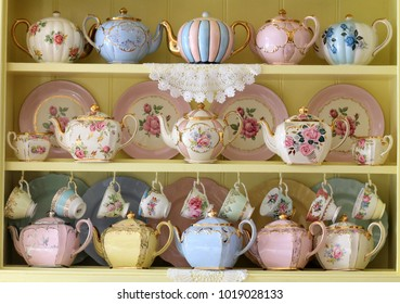 Vintage yellow kitchen dresser display of teacups tea cup teapots floral and pastel - high tea party
