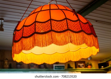 Vintage yellow lampshade from the ceiling