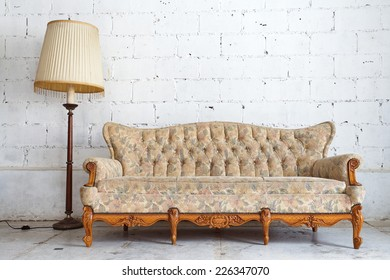 vintage yellow luxury armchair and white brick wall at background