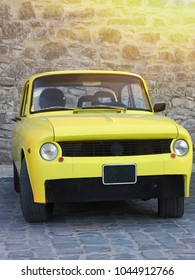 vintage yellow sports car oldtimer parked on a city pavement