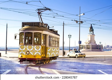 Vintage yellow tramway at the Commerce Square in Lisbon, Portugal