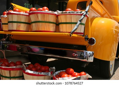 Vintage Yellow Truck with Baskets of  Red Tomatoes - Light noise in shadow area