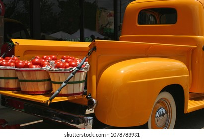 Vintage Yellow Truck with baskets of Red Tomatoes - Light noise in shadow areas