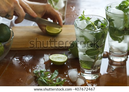 Vintage. Young girl preparing homemade mojito cocktail, alcoholic or non-alcoholic cocktail, closeup