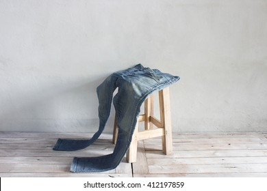Vintage,jean and on a chair Wooden floor