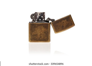 A vintage(old) zippo lighter opened isolated white.