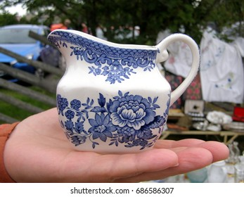 Vintages object selection old market. Ceramic milkman painted with the traditional blue white floral pattern. Close up