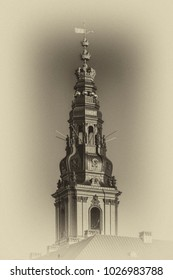 Vintage-style photo of old Christiansborg Palace Tower. Christiansborg Palace on Slotsholmen island, contains Danish Parliament (Folketinget), Supreme Court and Ministry of State. Copenhagen, Denmark.