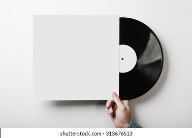 Vinyl cover on white wall background