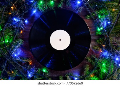 vinyl gramophone record in christmas style for christmas playlist background flat view and copy space