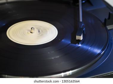 A vinyl LPrecord player on an analog turntable