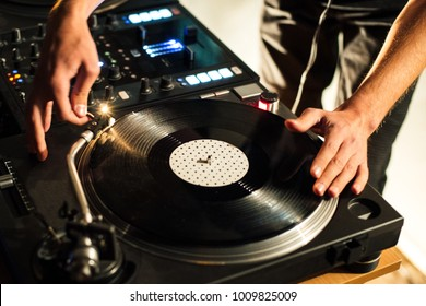 Vinyl music at a party, the DJ creates music