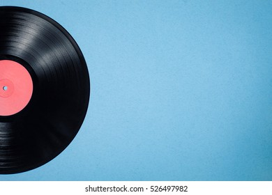 vinyl musical disc on blue background; vintage audiophile and musiclover postcard;