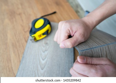 Vinyl plank floor tiles sheet installation can easily cut and folding by many kind of tools , DIY at home concept