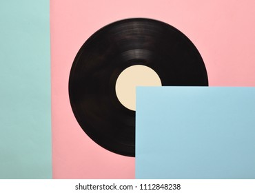 Vinyl plate on a colored pastel background. Retro musical attributes from the 80s. top view, minimalism. Copy space