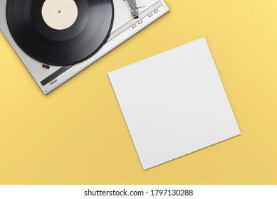 Vinyl player with long play or LP record and empty blank cover on yellow background. Top view.