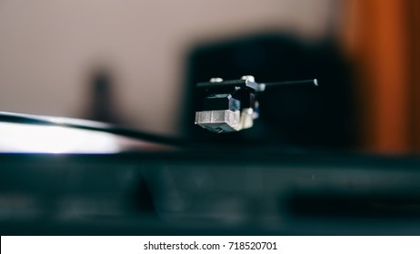 vinyl player while playing a vinyl close-up. Analog sound for audiophiles