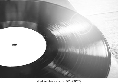 a vinyl record on a wooden table. background.