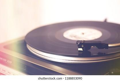 Vinyl record player, needle on vinyl record, vintage concept
