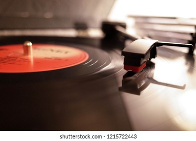 Vinyl record, record player and shell with a needle. Analog sound