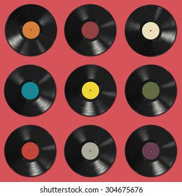 Vinyl records with colorful labels on red background. Seamless pattern. Raster version