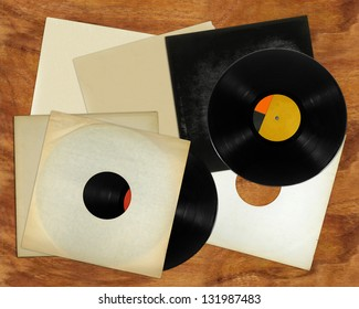 Vinyl records and covers on table