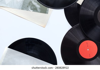 Vinyl records and paper covers on withe background