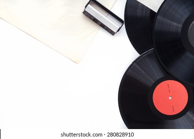 Vinyl records ,record clean brush and paper covers on withe background