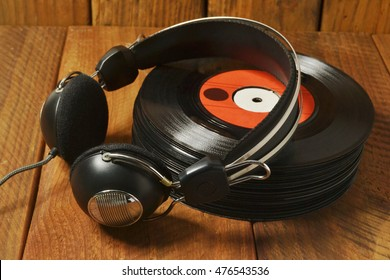 vinyl records stack with old vintage headphone