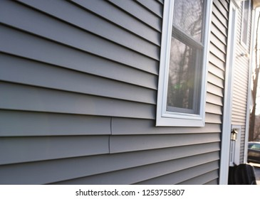 vinyl siding background showing windows and new home developments