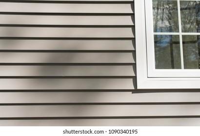 vinyl siding near a window frame on a new house
