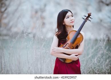 viola by a musician girl