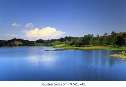 a violcanic crater lake in the parc naturel regional des volcans d'auvergne in the french massif central, cantal, auvergne, france, europe