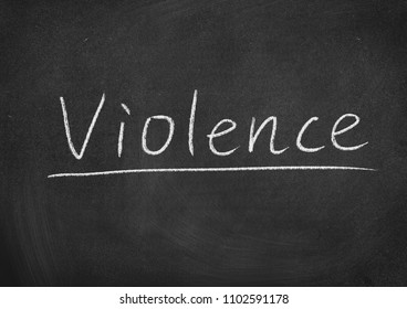 violence concept word on a blackboard background