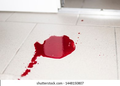 violence conceptual background which shows blood drops and splash is scary and dirty. A puddle of dried blood on the tiled bathroom floor.