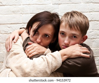 Violence  in the family. Mother  soothes her son