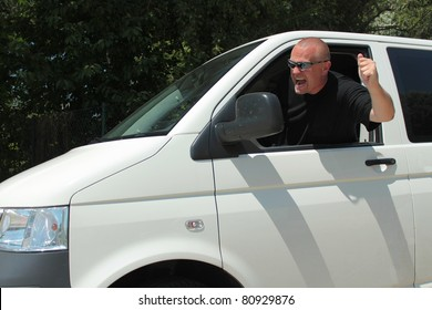 violent driver, in a big car, behind the wheel of violence