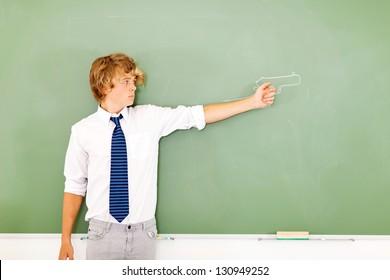 violent high school boy holding a gun drawn on chalkboard