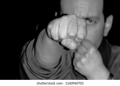 violent man put forth his fist to hit hard