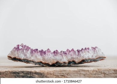 Violet amethyst crystal on wooden background. Copy, empty space for text